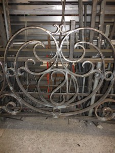 Wrought iron overthrow monogram detail