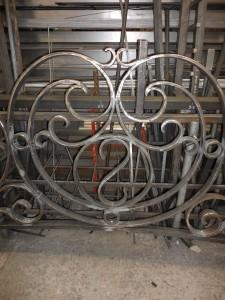 Wrought iron overthrow monogram detail