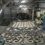 The team at work on the C16th wrought iron gates