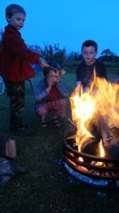 Boys around the brazier
