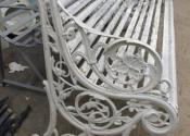 Decorative cast iron garden bench restoration