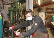 James making a panel of balustrading at Ironart