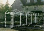 Wrought iron hooped arch pergola